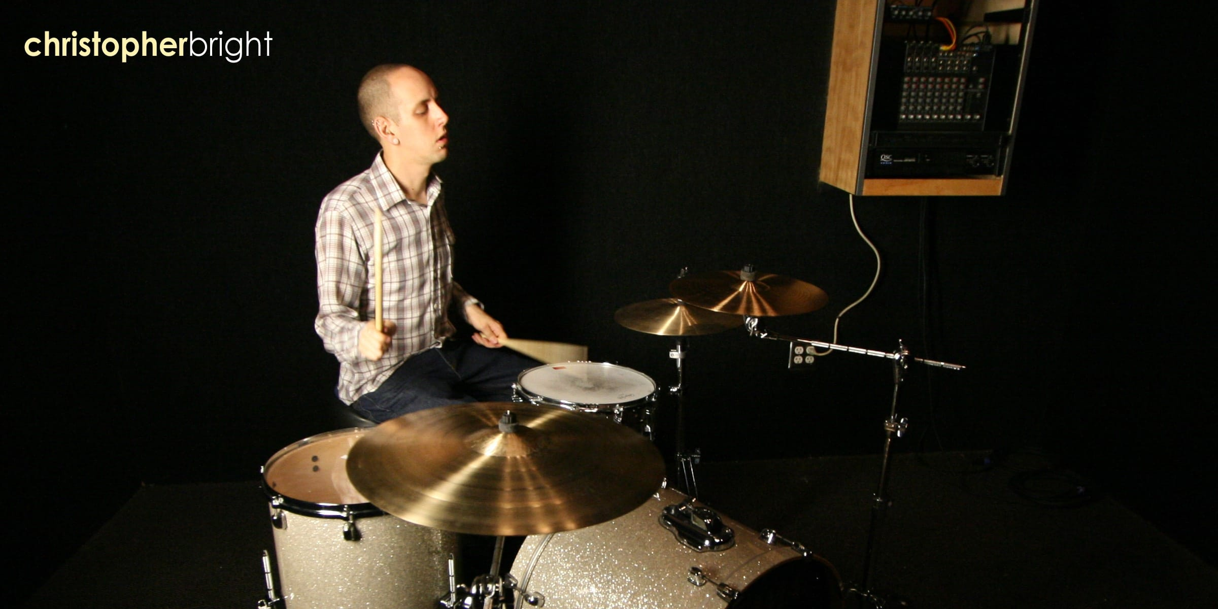 Musician Christopher Bright playing the drums